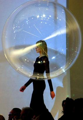 Italian fashion designer Gai Mattiolo  has unveiled his newest look, the retro-70s boy-in-the-bubble style.  Hoping the look will catch on with the masses, he has ordered 500,000 of the plastic bubbles in various sizes.