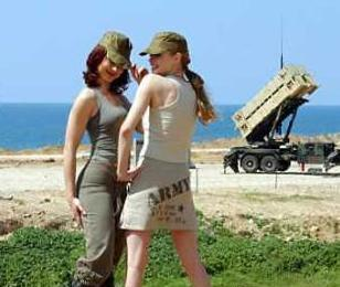 Two fashion models are photographed in front of a Patriot anti-missile system deployed in north Tel Aviv as part of the 'Shoot Your Missile' campaign designed to motivate US soldiers who have been languishing in the desert waiting for battle orders.  (Associated Press)
