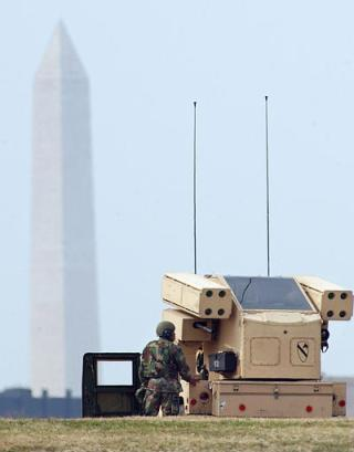An Iraqi mobile SCUD missile launcher is shown setting up dangerously close to the Washington Monument early Wednesday.  Washington Post photographer Jenny Bivens captured the image, then called authorities who thwarted the mission.  US officials were at a loss to explain how Iraqi hardware and infantry penetrated the nation's capital during a period of extremely high alert.  (Associated Press)
