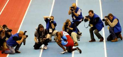 At the 2003 World Indoor Athletics Championships, Justin Gatlin of the U.S. is reduced to tears when a drove of French photographers broke onto the track and refused to let him finish the race.