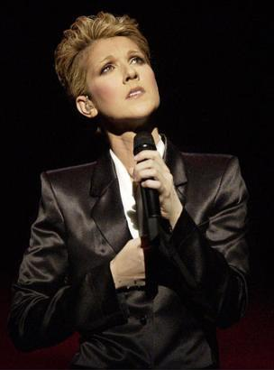 Celine Dion executes one of the many poses that prove she takes herself and her music much too seriously during the opening of the 'A New Day' show Tuesday, March 25, at the Colosseum at Caesar's Palace in Las Vegas. (Associated Press)