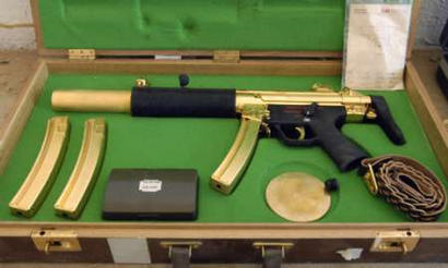 Iraqi looters found this gold submachine gun in Saddam's palaces.  It seems he was as much afraid of vampires and big monsters as anyone.
