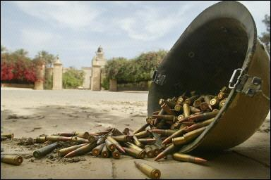 An abandoned Iraqi helmet filled with bullets lies on the ground in front of the entrance to the main Predidential Palace in Baghdad.  Baffled American scientists immediatly confiscated the helmet and will try to backwards-engineer the design elements and metallic properties for use in future US helmets.