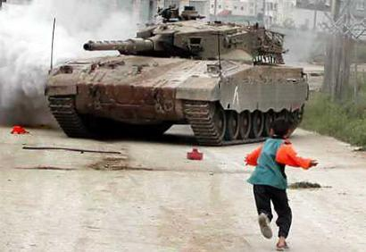 This is the 1,568,477th ?news? photo of a child or civilian hurling rocks at a tank somewhere in a war zone.  Experts agree that it is the most common photo taken during wartime, and that journalists still get a woody when they capture their first version of this.  News savvy readers, however, regard the photo as cliched and tired and many argue that the same group of pictures are merely being reprinted and recirculated, rather than new ones being taken at great risk to reporters. (Associated Press)