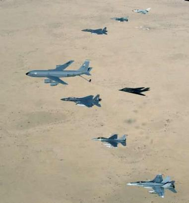 As bombing runs have essentially been stopped in the war against Iraq, bored fighter and bomber pilots have taken to aerial races over the Iraqi desert.  Here, a USAF KC-135 Stratotanker leads a British RAF GR-4 Tornado, USAF F-16 Falcon, USAF F-15 Eagle, USAF F-117 Nighthawk stealth fighter, USAF F-15E Strike Eagle, USAF F-16CJ, and Australian RAAF F/A-18 Hornet as the planes approach the finish line above Kabul Assr.  (Associated Press)