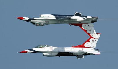 Two U.S. Air Force Thunderbirds fly too close to each other during the 2003 Air and Sea show in Fort Lauderdale, Florida, and become attached at the tail.  News commentators and radio DJs present at the show compared the incident to two teenagers with braces kissing.  The jets were able to land safely and surprisingly had great maneuverability during the 'attached' time. (Associated Press)