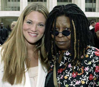 Elizabeth Regan and Whoopi Goldberg pose for a paparazzi photo.  Although close friends and insiders knew much earlier, the two have just announced their gala wedding plans and Regan's first pregnancy. (Associated Press)