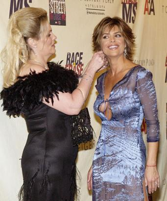 Nancy Davis, left, and actress Lisa Rinna arrive at the tenth annual 'Race to Erase MS,' Friday, May 9, 2003, in the Century City area of Los Angeles. Davis, who was diagnosed with MS in 1991, is the founder of the annual 'Race to Erase MS' event.  Rinna mistakenly thought the event was the 'Race to Erase My Dress,' however, but graciously endured the evening anyway. (Associated Press)