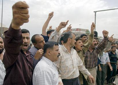 Thousands gather at a protest in Baghdad, Iraq, to speak out against CocaCola changing its formula.  Although Coke had announced the formula change on April 23, 1985, and re-engaged production of the original formula 2 months later, Iraqis did not find out until the fall of Saddam Hussein.