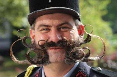 Frenchman Herve Diebolt, a participant of the international World Beard and Moustache Championships smiles in Gruendau near Frankfurt September 19, 2009. Over 160 participants compete in 17 categories of beard and moustache styles. Diebolt won in the inaugural Jackwipe Crapface category.