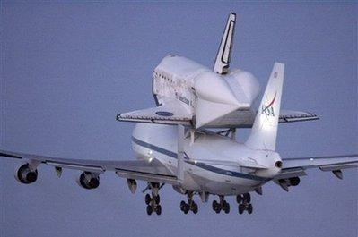 The space shuttle Discovery, mounted atop a modified Boeing 747 shuttle carrier, lifts off from Edwards Air Force Base, California, on Sunday, September 20, 2009. The space shuttle Discovery is on a cross-country flight to Florida following drastic budget cuts at NASA.  Astronauts are expected to eat at least two meals and use the bathroom during the eight-hour, regular-gravity trip before returning to earth later that day.  No other experiments or activities are planned during the short mission.