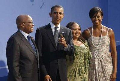 South Africa's President Jacob Zuma poses with U.S. President Barack Obama, daughter Malia, and first lady Michelle Obama as they arrive at the Phipps Conservatory for an opening reception and working dinner for heads of delegation at the G20 Summit in Pittsburgh, Pennsylvania, September 24, 2009. (REUTERS)
