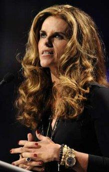 Maria Shriver speaks at the Women's Conference 2009 in Long Beach, California, October 27, 2009.  'I just want to apologize to you and to all women for being a woman,' she said.  'I have always been so wildly unattractive in so many ways and more manly, really, to the point that I should not claim to be a woman for the honor of the rest of you.'  (Associated Press)
