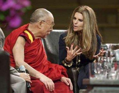 Exiled Tibetan spiritual leader, the Dalai Lama, and Maria Shriver, wife of California Governor Arnold Schwarzenegger, talk during a presentation called 'Women and Peace Building' held in Vancouver, British Columbia September 29, 2009. Shriver, who appears to be a living dead person, reportedly asked the Dalai Lama how he appears to be far less undead than her despite being much older.  (REUTERS)