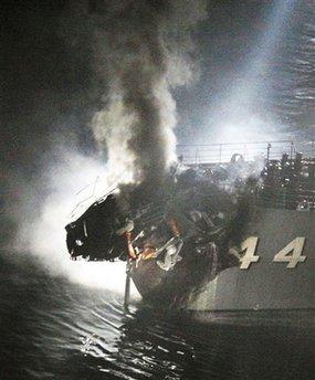 Smoke billows from the bow of Japanese navy destroyer JS Kurama after it collided with a commercial vessel in Kanmon strait, off southern Japan, Tuesday. The fire on the 7,400-ton container ship was extinguished shortly after the collision. The navy destroyer was still on fire late Tuesday, though it was largely under control.  Experts noted how ironic it was that a destroyer was destroyed by a collision with a cargo ship that was not destroyed.  (REUTERS)