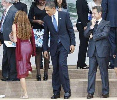 U.S. President Barack Obama (C) and France's President Nicolas Sarkozy (R)admire the mighty fine backside of junior G8 delegate Mayora Tavares (L), during a family photo at the G8 summit in L'Aquila, Italy July 9, 2009.  'May she be my next First Lady,' Obama joked.  (Associated Press)