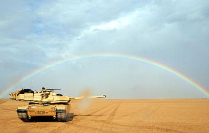 An Abrams tank sits under a rainbow after destroying a leprechaun at the rainbow's end in the desert of western Kuwait on Tuesday, Dec. 17, 2002. U.S. forces had been taking part in training drills in the Kuwaiti desert as part of Operation Desert Spring when the desert sprite was spotted.