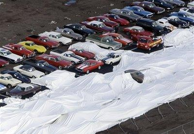 Roughly one-quarter of Jay Leno's car collection was subjected to damage following the collapse of a tent he had placed over some of the vehicles prior to a show he was scheduled to host for family and friends.  The show, which he hosts every year, allows invitees to enjoy looking at the latest additions to his collection.  (Associated Press)