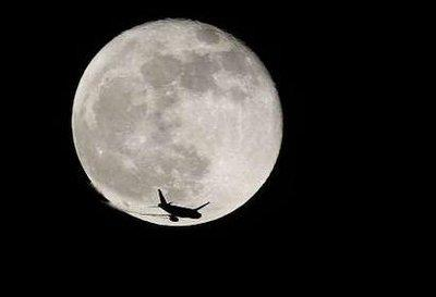 A US Airways jet narrowly misses colliding with the moon on a flight last Saturday, US Airways officials disclosed.  The flight, which carried 268 passengers and crew, managed to pass just below the moon and later landed safely at Chicago's O'Hare Airport.  (Associated Press)
