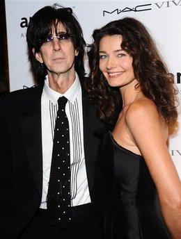 Musician Ric Ocasek and wife, former model Paulina Porizkova, pose for a publicity photo recently in Los Angeles.  Ocasek recently revealed he will undergo experimental surgery to reduce the size of his Adam's apple, which has grown to a proportion that has required that he purchase two tickets when flying on commercial airlines.  The decision to have the surgery, however, was not one the couple agreed on.  'I'll miss that huge knob,' Porizkova lamented, 'that huge, hard, protruding knob.'  (Associated Press)