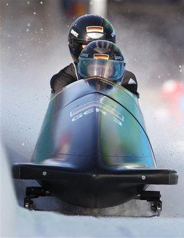 Germany's GER-3, piloted by Karl Angerer, front, practices during a training run for the men's two-man bobsled at the Vancouver 2010 Olympics in Whistler, British Columbia.  The German sled is powered by a three-liter BMW engine capable of 280 horsepower, and is expected to bring home the gold.  The American entry is powered by a Chevrolet V-6 that is far less powerful, but is expected to get nearly 40% better gas mileage.  (Associated Press)