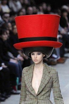 A model presents a creation by Belgian designer Walter Van Beirendonck during the Autumn/Winter's 2010-2011 ready-to-wear collection show in Paris.  It is estimated that fewer than one of the hats will ever be sold anywhere in the world for obvious reasons.  'Fashion designers are an eclectic, insane group of people who make things up for reasons known only to themselves,' said one insider.  'Van Beirendonck, for example, is in his fourteenth year of a rabies infection, and hasn't spoken to a soul in the last year.'  (REUTERS) 