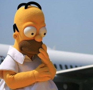 Actor Homer Simpson, who portrays Homer Simpson on the long-running Fox show, 'The Simpsons,' contemplates his next move at the Springfield Airport after being bumped from a crowded flight headed to Vegas.  Simpson was believed to have opted to take an animated flight to an animated Las Vegas in order to film an upcoming episode.  (Associated Press)