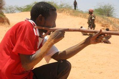 A Somali army recruit is shown just seconds before he was killed by gunfire outside Camp al-Jazira, the government's main military base, in Mogadishu, Somalia.  Because the Somali army is so poor, it cannot afford guns for all of its soldiers and has been known to send some into battle with only sticks. (REUTERS)