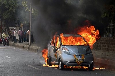 Mumbai, India (AP) - A brand new silver Tata Nano, heralded as the world's cheapest car, burst into flames shortly after Satish Sawant, a software engineer, proudly drove the car home from the dealership showroom, still draped with a celebratory garland of marigolds.  On Monday, Toyota placed an order for 30,000 of the cars, stating that, 'a car bursting into flames is much more exciting than a gas pedal getting stuck.'  Toyota will convert the car into a hydrogen hybrid and rename it the 'Phoenix.'  They are expected to hit showrooms by the third quarter of 2011.