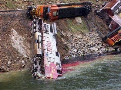 This photo shows a train derailment, Wednesday, May 12, 2010 in Thermopolis, Wyoming. The locomotive slid into the Wind River after swerving to avoid a squirrel on the tracks south of Thermopolis. The crew survived but diesel fuel is leaking into the river which is now likely to kill many fish and animals, including the squirrel.  PETA officials could not be reached for comment. (Associated Press)