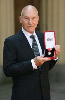 Actor Patrick Stewart poses with his knighthood after he was knighted by Britain's Queen Elizabeth at Buckingham Palace in London June 2, 2010.  During the ceremony, Stewart delivered a powerful speech denouncing Romulans and declaring it his goal as a knight to rid the known Universe of their existence.  Jonathan Frakes was on hand for the ceremony and quickly whisked Stewart away in a shuttle.