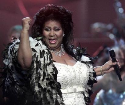 Aretha Franklin the 'Queen of Soul,' performs during the 'VH1 Divas 2001: The One and Only Aretha Franklin' tribute Tuesday, April 10, 2001, in New York. Franklin will be on hand as Michigan's first woman governor is sworn in next week. She is scheduled to scream and wail wildly in the manner which has long been embraced as entertaining and musical by those who have never heard cats fight or barnyard animals mate. (United Press International)