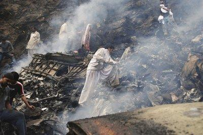 Pakistani rescue workers look for survivors in the wreckage of a plane that crashed in Islamabad, Pakistan on Wednesday, July 28, 2010. A government official says all 152 people on board the plane that crashed in the hills surrounding Pakistan's capital were killed.  'It's not so much a search for survivors, really,' one official stated, 'because if we do find anyone alive they still have to live in Pakistan, which is worse than dying.'  (REUTERS)