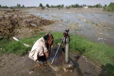 Afghan inventor Khyber Pakhtunkhwa demonstrates his new mud pump, which he envisions will provide mud for millions of starving families around the world.  'It is like thick, chunky water, which makes drinking more like a meal for those who cannot find or afford food,' Pakhtunkhwa stated.  (REUTERS)
