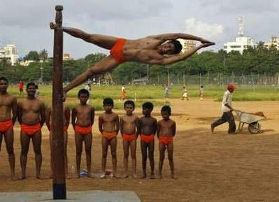 A man is tied to a Mallakhamb (punishing pole) during a torture session at a prison in Mumbai. Mallakhamb is a punitive measure administered to those who wear small orange shorts in public and it can be traced back to the 12th century. For centuries, the punishment has been dormant but is now regaining popularity in the country as small orange shorts make a comeback in India. (REUTERS)