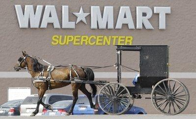 A news photo shows an Amish buggy driving away from the Walmart store in Middlefield, Ohio, recently. Store manager Karen Gibbons confirmed that the buggy's owner, Elijah Wolcott, purchased a Hamilton Beach handheld blender and a 32' LCD television.  Gibbons said Wolcott paid for the items with two goats and a chicken, and has purchased over two miles' worth of extension cords over the last several months, leading local officials to believe the Amish are stealing electricity from an unknown public or private party.  (Associated Press)