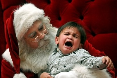 Josiah Waikiki, 2, cries as he is told by a department store Santa Claus in Las Cruces, NM, that the real Santa Claus is dead.  Santa Claus was killed in a collision with a tow truck in Montross, NJ, in 1969. (Associated Press)