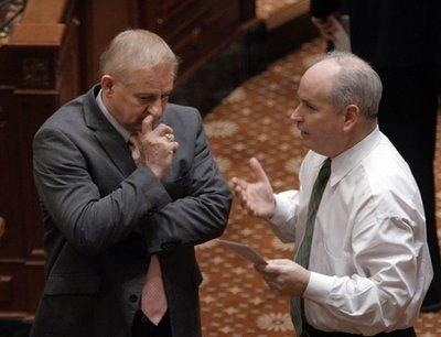 Representatives Dan Brady, left, R-Bloomington, and Roger Eddy, R-Hutsonville, confer on the House floor during a session at the state Capitol in Springfield, Il., regarding Brady's long-standing nickname of 'Booger Boy Brady.'  (Associated Press)