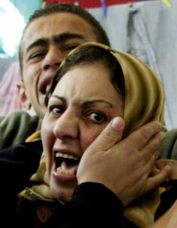A Palestinian woman and her son react to the news of the death of Bee Gee Maurice Gibb Saturday.  Although Saturday Night Fever was not shown there until 1996, Palestinians quickly embraced The Brothers Gibb and have held them close to their hearts despite all of the tensions and strife in the region.  (Associated Press)