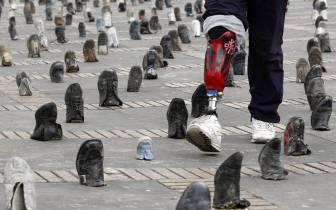 A man with a fake leg browses through an outdoor One-Legged Shoe Mart in Bogota, Colombia.  Bogota leads the world in one-legged citizens due, in large part, to both birth defects and drug-related land mines.  (Associated Press)