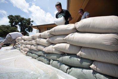 Despite the threat of rising waters from the surging Mississippi river, drug dealers in Louisiana continue with business as usual by laying out huge, 120-pound bags of cocaine for sale in local farmers' markets.  'We satisfy demand, and demand isn't dipping yet,' said Marcos DeNueva. (Associated Press)