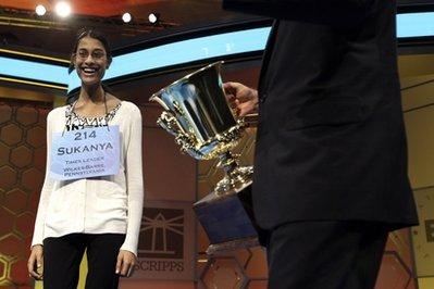 Sukanya Roy, 14, of South Abington Township, PA, is presented the trophy after winning the National Spelling Bee. She won by spelling the word cymotrichous, which means wavy hair. Officials are considering a disqualification of Roy, however, because it was revealed that she misspelled her name on entry forms.