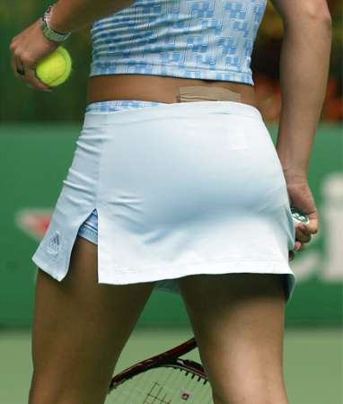 Although photographers took this picture to highlight the patch on Anna Kournikova's back (it was rumored to be covering a tattoo), 95% of men polled never noticed any patch.