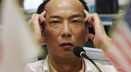 A Japanese guy uses his hands to demonstrate how Asian people have slanty eyes. 'We Asian people look different than most because of the way that our eyes are slanted instead of normal like all the other normal people in the world,' the man said through an interpreter. 'We are sorry that we look this way,' he added. (Associated Press)