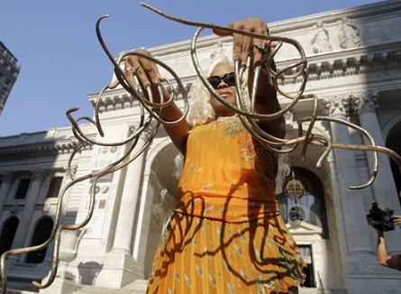 Chris 'The Dutchess' Walton shows off her record breaking fingernails in New York, Wednesday, Sept. 14, 2011. The Dutchess holds the world's record for the longest fingernails on a pair of female hands, according to the new Guiness World Records 2012 book, and recently signed a contract to be the spokesperson for Kohler Corporation's new luxury line of bidets.
