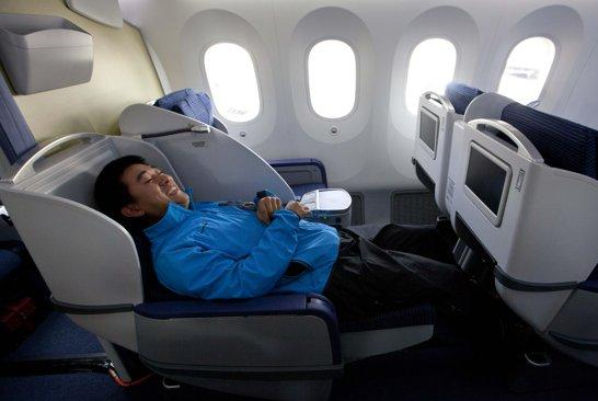 Kang Kang of China Central TV sits in the reclining seat as the news media tour the second Boeing 787 to be delivered to All Nippon Airways at the assembly plant in Everett, Washington. Okay, wait a second. There's NO WAY the dude's name is Kang Kang. What? He's Chinese. Maybe he didn't understand the question, or maybe he said his first name twice because he thought the American was fat and was thinking about food or something. 'Kang Kang?' I'm not buying that noise. (AP Photo/John Fr