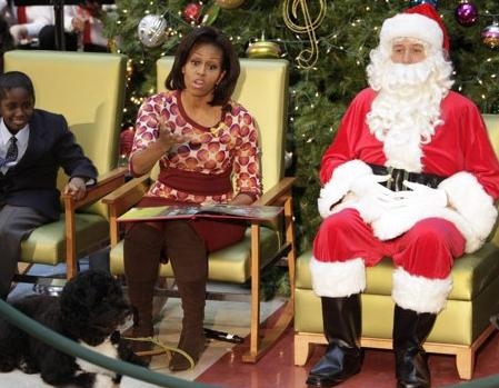 First Lady Michelle Obama expresses dismay over her public appearance with a white Santa in Washington, DC, recently. 'Don't look like any damned Santa I know,' she said. (Associated Press)
