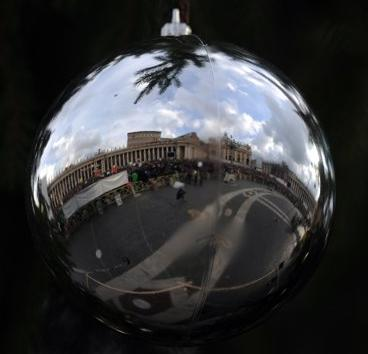 St Peter's Square is reflected in a Christmas ornament in a photo taken by journalist Gabriel Buoys. 'I saw the Square in the ornament and didn't realize until later that it was probably a reflection of the Square behind me because I just kept walking in the same direction,' Buoys commented. 'I could have simply turned around and taken a better picture of the area and avoided the distorted perspective.' (Associated Press)