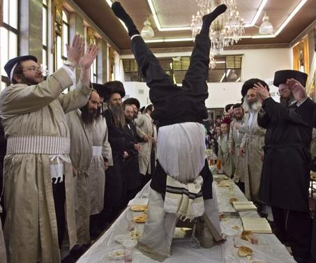 Hassidic Jews, who don't believe in stripping, strippers, or strip clubs because of something they probably read in the Bible or whatever, whip up their own brand of Partytime at a recent get-together while celebrating the Jewish holiday of Purim in Jerusalem's Mea Shearim neighbourhood. (Associated Press)