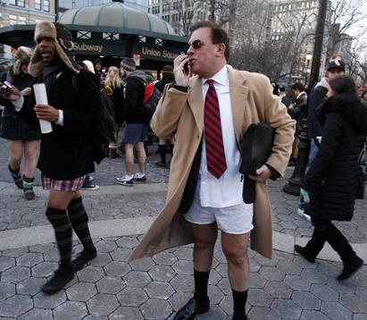 A man talks on his cell phone after taking part in the 10th Annual No Pants Subway Ride in New York City. Sponsored by Subway Sandwich Shops, the ride features both 'six inch and foot longs that even Jared would enjoy with a little extra ranch,' one official stated. (Associated Press)
